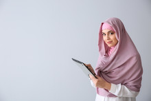Young Muslim Woman With Tablet...