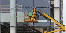 Workers On A Cherry Picker. Th...
