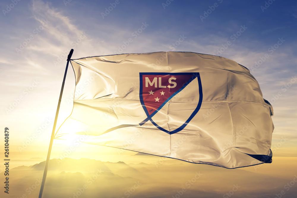 Fototapety, obrazy: MLS Major League Soccer logo flag waving on the top sunrise mist fog