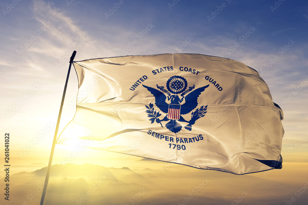 Fototapety, obrazy: United States Coast Guard flag waving on the top sunrise mist fog