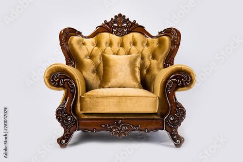 Foto  Luxurious vintage gold armchair on white background