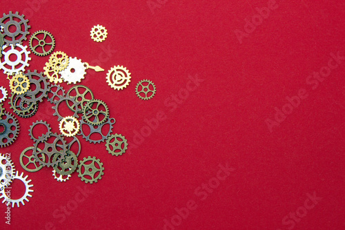 Photo  Steel gear gears on a Red background.