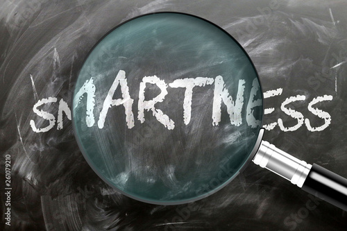 Fotografía  Learn, study and inspect smartness - pictured as a magnifying glass enlarging wo