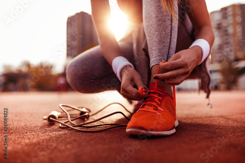 Fototapeta Woman preparing for jogging