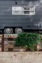 A Renovated Black Caravan Or T...