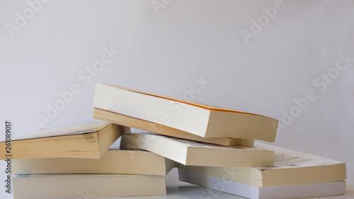 Obraz Heap of books isolated on white background. - fototapety do salonu