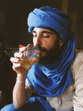 Tourist Man In A Headscarf  Drinks A Moroccan Tea.