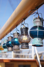 Decorative Old Lamps Hanging On A Ship