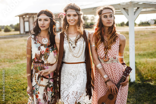 Three cute beautiful hippie girl in the setting sun, outdoors, the best of frien Canvas Print