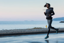 Young Attractive Woman In Good Shape Jogging Early In The Morning