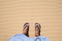 Male Feet In Flip Flops Standi...