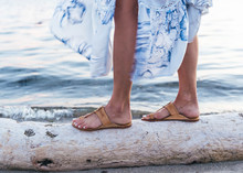 Close Up Shots Of Girl Wearing Sandals By The Beach At Dusk