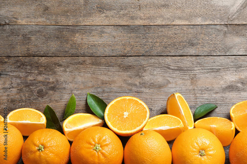 Fototapety, obrazy: Flat lay composition with ripe oranges and space for text on wooden background