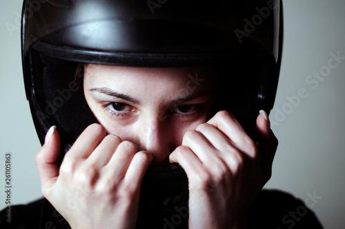 Photo  Female biker with helmet, dangerous sport