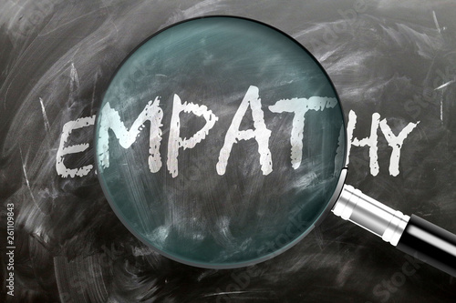 Fotografia  Learn, study and inspect empathy - pictured as a magnifying glass enlarging word