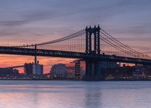 Manhattan Bridge With The Moon From East River At Sunrise