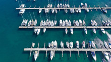 Aerial Drone Top View Photo Of Mediterranean Port With Sail Boats Docked