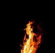 mystical orange burning fire fighting against the dark