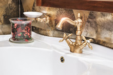 Retro Golden Faucet In The Bat...
