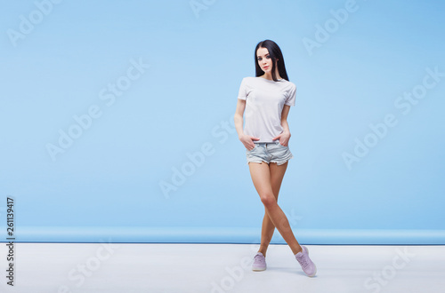 Fotografie, Obraz  Amazing woman in white T-shirt and denim shorts