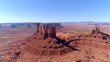 Beautyful Monument Valley Aerial, Utah, Arizona, Navajo National Park, Layered monumental Red rocks with the desert landscape overview. West of America. 4K drone footage.