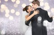canvas print picture - Happy just married young couple dancing on blurred background