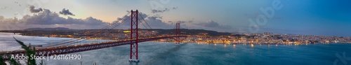 Photo sur Toile Bleu nuit Crossing The Tagus River. Amazing Panoramic Image of Lisbon Cityscape Along with 25th April Bridge (Ponte 25 de Abril). Taken from Almada District