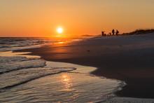 Sun Setting On Beach Fishermen On Okaloosa Island In North-western Florida