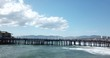Santa Monica Pier dock with tourists and locals walking Shot from side over water in 4k at 30 frames per second.mov