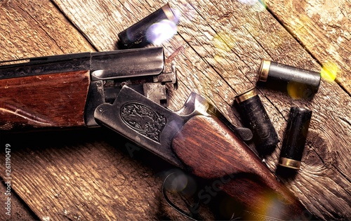 Vintage rifle and sleeves on wooden table Canvas Print