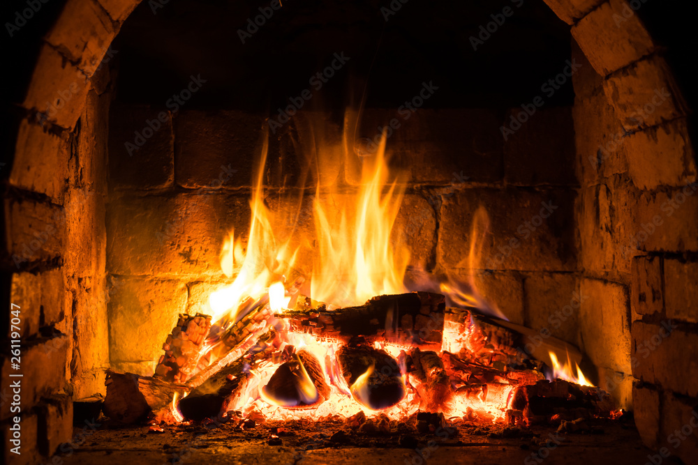 Fototapety, obrazy: Wood burning in a cozy fireplace at home, keep warm