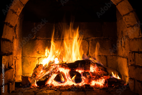 Wood burning in a cozy fireplace at home, keep warm Fototapeta