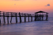 Abstract Old wooden jetty pier long exposure during beautiful sunset