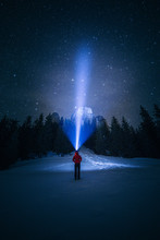 Silhouette Of Hiker Person With Flashlight On Head Watching The Starry Sky In The Mountains. Location Carpathian,Romania,Transylvania