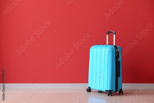 Fototapety, obrazy: Packed suitcase near color wall