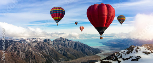 Poster Montgolfière / Dirigeable Beautiful panoramic nature landscape of countryside mountains with colorful high hot air balloons festival in summer sky. Vacation travel panorama background.