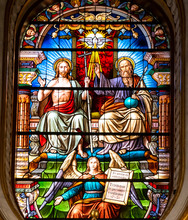 Colorful Stained Glass Showing Chris, Saint Peter And An Angel