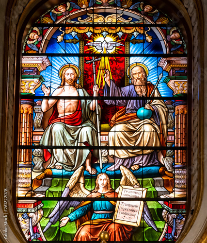 Photo  Colorful stained glass showing Chris, Saint Peter and an angel