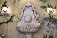 Ancient Sculpture Of Fountains With A Lion Head