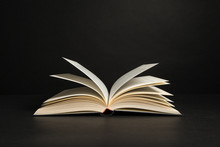 Open Book With Pages On A Black Background