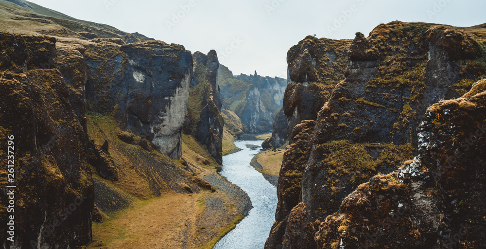 Fototapety, obrazy: Unique landscape of Fjadrargljufur in Iceland. Top tourism destination. Fjadrargljufur Canyon is a massive canyon about 100 meters deep and about 2 kilometers long, located in South East of Iceland.