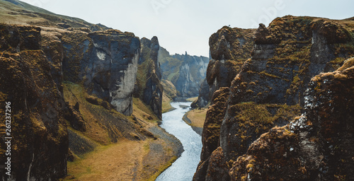 Obraz Unique landscape of Fjadrargljufur in Iceland. Top tourism destination. Fjadrargljufur Canyon is a massive canyon about 100 meters deep and about 2 kilometers long, located in South East of Iceland. - fototapety do salonu