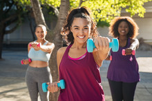 Happy Curvy Women Using Dumbbells