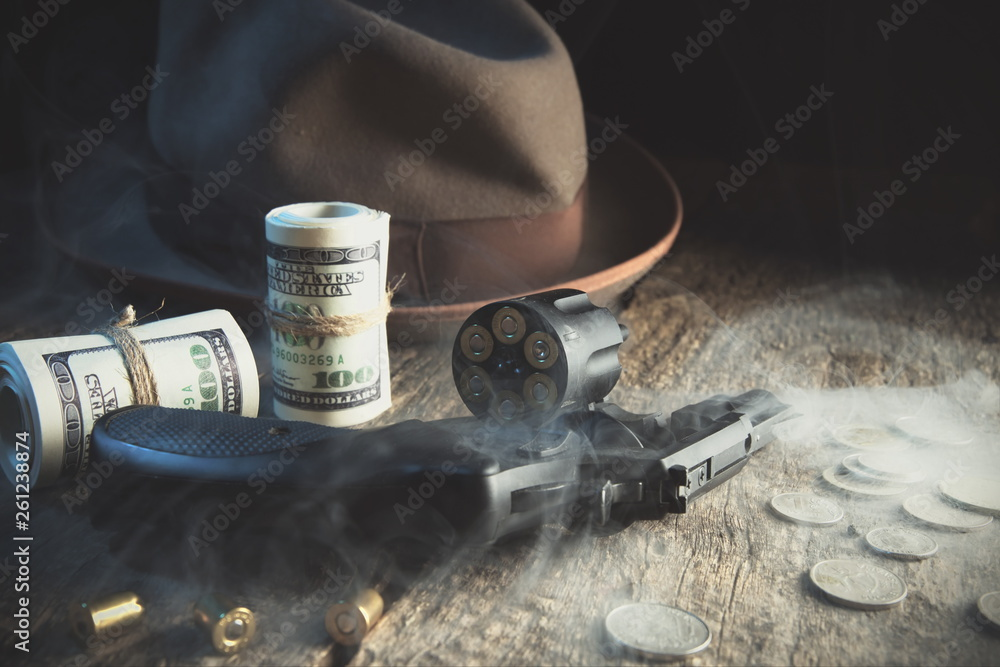 Fototapeta Guns and money.Gangster coat,bullet,dollars .The concept of crime.Smoky background.Retro and vintage style.