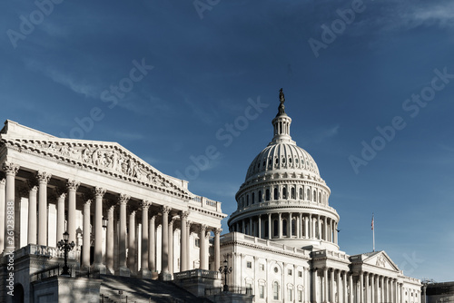 Fotografia  Capitol Building with blue sky from side view, Symbol of Washington DC, United s