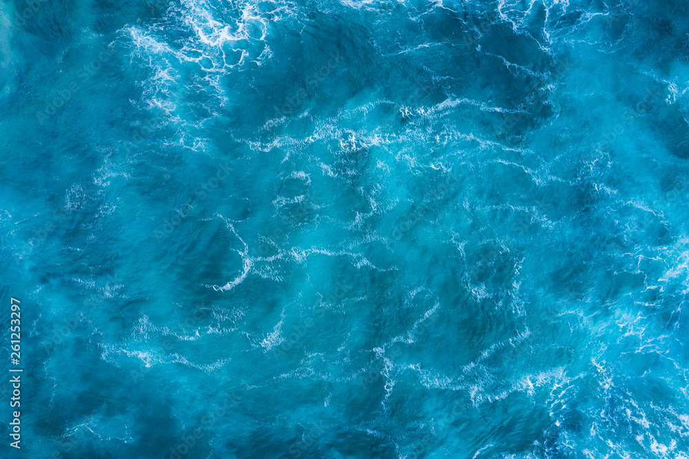 Fototapeta Top view of blue frothy sea surface. Shot in the open sea from above.
