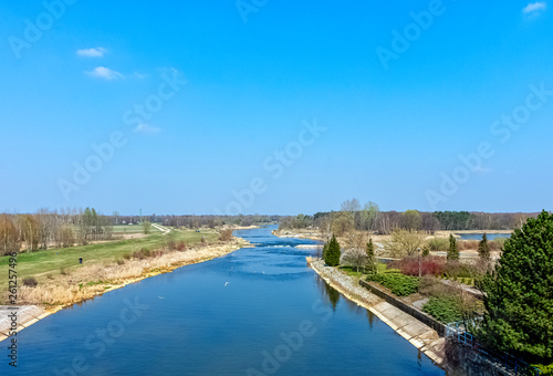 Poster Channel Panoramic view of Warta River in Lyszkowice, Poland