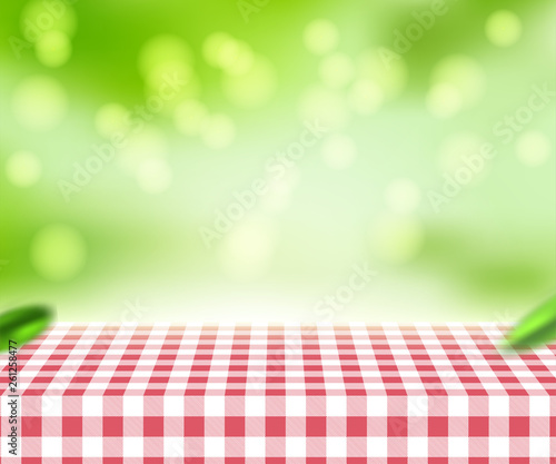 Aluminium Prints Picnic Red checkered tablecloth texture top view with abstract green bokeh from garden in morning background.For montage product display or design key visual layout