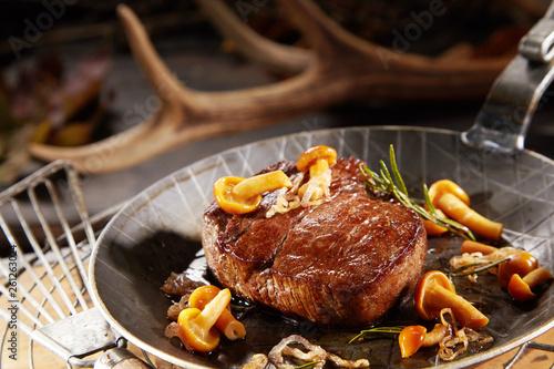 Photo  Gourmet thick marinated grilled wild venison steak