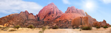 Spitzkoppe Mountains Range Panoramic View On Blue Sky, Clouds And Bright Sun Background, Red Mountain Rocks Panorama Landscape In Namibia, Southern Africa, Beautiful Tourist Banner Design, Copy Space